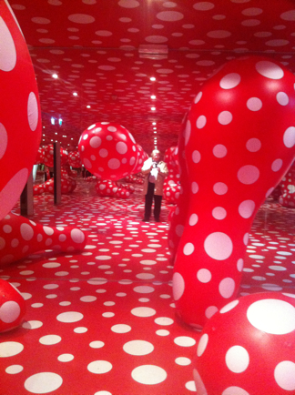 Standing in the middle of a red room-like sculpture covered in white polka  dots, I was again reminded of just how different the artist's world and the  ...